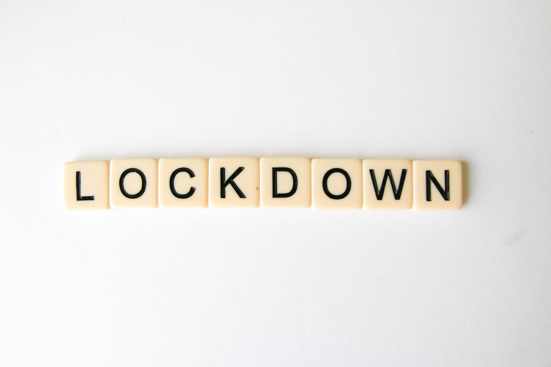 "Cream coloured square tiles with black letters spelling the word ""Lockdown"""
