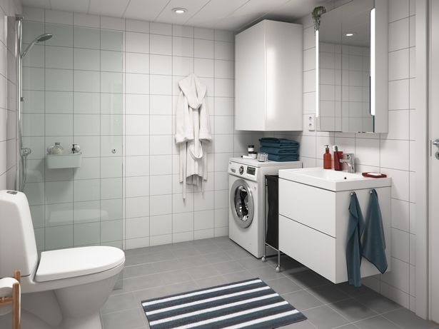 Inside of BoKlok house, showing a stylish but functional bathroom/utility space